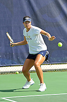 18 March 2012:  FIU's Christine Serendi returns the ball during her doubles match against Columbia's Katarina Kovacevic and  Crystal Leung as the Columbia Lions defeated the FIU Golden Panthers, 5-2, at University Park in Miami, Florida.