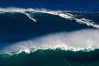 A tow-in surfer drops into Hawaii's big surf at Peahi (Jaws) off Maui.