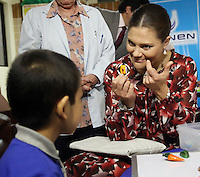 Crown Princess of Sweden Victoria and doctor  Tatiana Vidaurre. share a game with kids under chemotherapy treatment at the National Cancer Institute (INEN) in Lima, Peru, October 20 2015. The Princess is in the second day of her visit to Peru along with her husband  Daniel Westling.<br /> <br /> <br /> Foto Geraldo Caso/Archivolatino/Astufoto