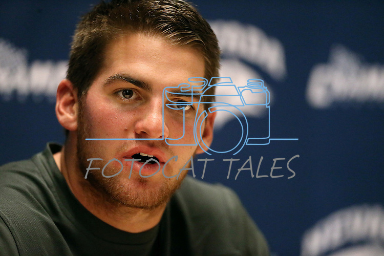 Nevada quarterback Cody Fajardo answers media questions following a 31-24 loss to Colorado State in an NCAA college football game in Reno, Nev., on Saturday, Oct. 11, 2014. (AP Photo/Cathleen Allison)