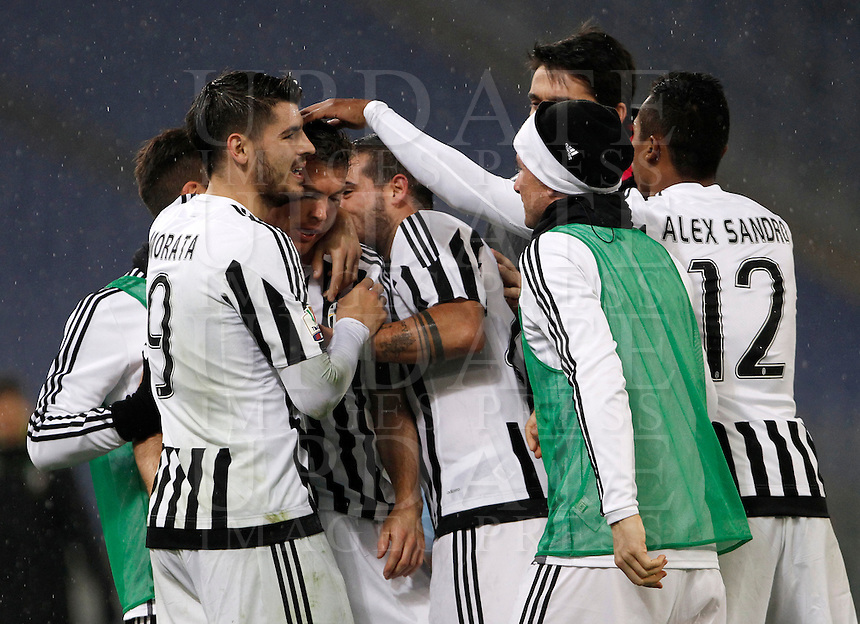 Calcio, quarti di finale di Coppa Italia: Lazio vs Juventus. Roma, stadio Olimpico, 20 gennaio 2016.<br /> Juventus' Stephan Lichsteiner, second from left, celebrates with teammates after scoring after scoring during the Italian Cup quarter final football match between Lazio and Juventus at Rome's Olympic stadium, 20 January 2016.<br /> UPDATE IMAGES PRESS/Isabella Bonotto