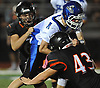 Kyle Szokoli #1, Glenn quarterback, fights for yards as Eric Marsden #60, left, and Matt Moretti #43 of Babylon bring him down during a Suffolk County Division IV varsity football game played at Babylon High School on Friday, Oct. 6, 2017. Babylon won by a score of 28-7.