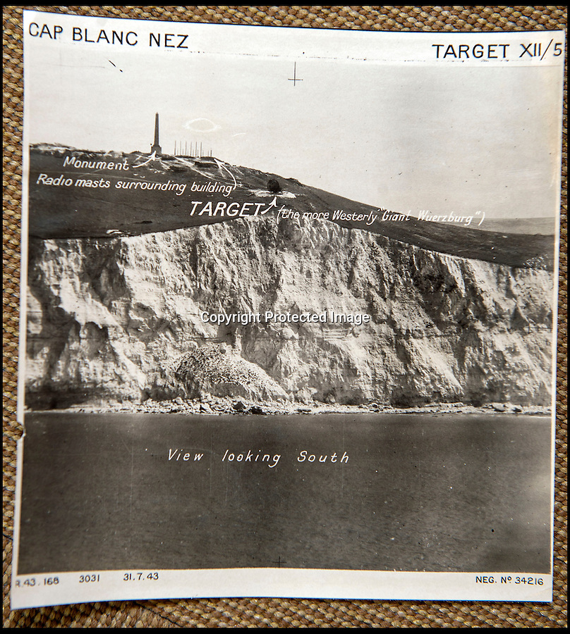 BNPS.co.uk(01202 558833)<br /> Pic: C&TAuctions/BNPS<br /> <br /> Diversionary attack plans with targets marked for the cliffs west of Calais<br /> <br /> Found in a french flea market - a Top Secret 'how to' guide to D-Day.<br /> <br /> Fascinating top secret documents and photos of the extensive planning that went into the Normandy invasion have emerged after 72 years.<br /> <br /> Incredibly detailed plans of Nazi defences, high resolution photographs, weekly intel reports and even analysis of the German weapons they were likely to face are included in the sale.<br /> <br /> One photo taken at zero feet shows German troops scattering across a beach as a low-level RAF aircraft sweeps by to capture the plethora of anti-landing obstacles.<br /> <br /> Other images show the famous coastline with key cliff-top targets that had to be destroyed either before or on D-Day itself.<br /> <br /> The archive is being sold by C&T Auctions of Kent.