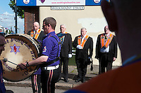 Belfast, Northern Ireland, United Kingdom, May 2011. Protestant Orange Order men march through the streets of Shankill. During The Troubles, the Greater Shankill and its residents were subjected to bombings and shootings by Irish republican paramilitary forces, the most notable of which was the Shankill Road bombing. The Shankill was also a centre for loyalist paramilitarism. The modern Ulster Volunteer Force (UVF) had its genesis on the Shankill. Similarly the Ulster Defence Association, established in September 1971, also began on the Shankill. For decades travellers stayed away from the sectarian violence, but since the end of'The Troubles' more and more people start discoving the beauty of Belfast and the Antrim Coast Causeway. Photo by Frits Meyst/Adventure4ever.com