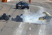 Feb 25, 2018; Chandler, AZ, USA; NHRA funny car driver John Force (right) crashes with Jonnie Lindberg during the Arizona Nationals at Wild Horse Pass Motorsports Park. Mandatory Credit: Mark J. Rebilas-USA TODAY Sports