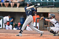 Pulaski Mariners shortstop Gianfranco Wawoe #7 swings at a pitch during a game against the Greenville Astros at Pioneer Park July 12, 2014 in Greenville, Tennessee. The Mariners defeated the Astros 11-10. (Tony Farlow/Four Seam Images)