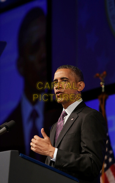 Barack Obama.United States President Barack Obama speaking at the Planned Parenthood Gala at the Washington Marriott Wardman Park Hotel in Washington, DC, USA, April 26, 2013..half length podium American flags suit tie speaking purple politics microphone .CAP/ADM/CNP/CK.©Chris Kleponis/AdMedia/Capital Pictures