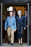 © Joel Goodman - 07973 332324 . 02/10/2017. Manchester, UK. Prime Minister THERESA MAY and husband PHILIP MAY leave the Midland Hotel at the start of the second day of the Conservative Party Conference at the Manchester Central Convention Centre . Photo credit : Joel Goodman