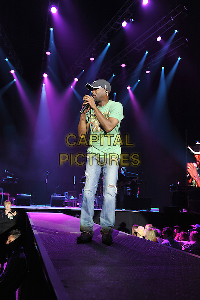Darius Rucker.Performing live at the O2 Arena, London, England..August 17th, 2011.stage concert live gig performance music full length jeans denim green t-shirt baseball cap hat singing.CAP/MAR.© Martin Harris/Capital Pictures.