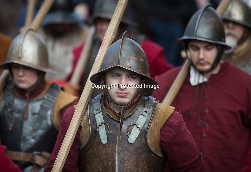 29/01/17<br /> <br /> It was more 'mud sweat and tears' than 'blood sweat and tears' as seven hundred Sealed Knot 'soldiers' reenact the Battle of Nantwich, in on a damp field next to the the river Weaver in Nantwich, Cheshire.<br /> <br /> The day is known as Holly Holy Day, after the townsfolk wore sprigs of holly in their hats to celebrate the lifting of the siege in 1644 - it is said this is where the word 'holiday' originates.<br /> <br /> The Battle of Nantwich was fought during the First English Civil War, between the Parliamentarians and Royalists, northwest of the town of Nantwich in Cheshire on 25 January 1644. <br /> <br /> The Royalists under Lord Byron were besieging Nantwich, and Sir Thomas Fairfax led an army to relieve the town. As Fairfax approached, a sudden thaw caused the River Weaver to rise in spate, dividing Byron's cavalry from his infantry and artillery, who were overrun and destroyed by Fairfax.<br /> <br /> The Parliamentarian victory halted a run of Royalist successes in the area, and was a major setback to King Charles I's plan of campaign for the year.<br /> <br /> <br /> All Rights Reserved F Stop Press Ltd. (0)1773 550665 www.fstoppress.com