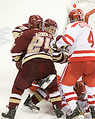 Paul Carey (BC - 22), Bill Arnold (BC - 24), Sean Escobedo (BU - 21), Adam Clendening (BU - 4) - The visiting Boston College Eagles defeated the Boston University Terriers 3-2 to sweep their Hockey East series on Friday, January 21, 2011, at Agganis Arena in Boston, Massachusetts.