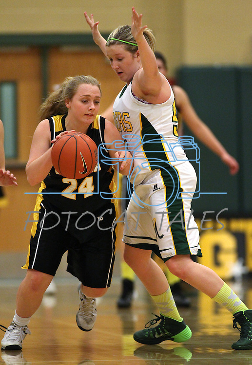 Manogue's Madison Lewis pressures Galena's Mackenzi McKee at Manogue High School in Reno, Nev., on Tuesday, Feb. 11, 2014. Manogue won 51-29.<br /> Photo by Cathleen Allison