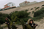 Israeli soldiers on an infantry drill, near the Israeli settlement of Rafiach Yam, in the settlement bloc of Gush Katif, Gaza Strip. The settlement, located at southern Gaza, neighbors the Palestinian city of Rafah. March 9, 2005.