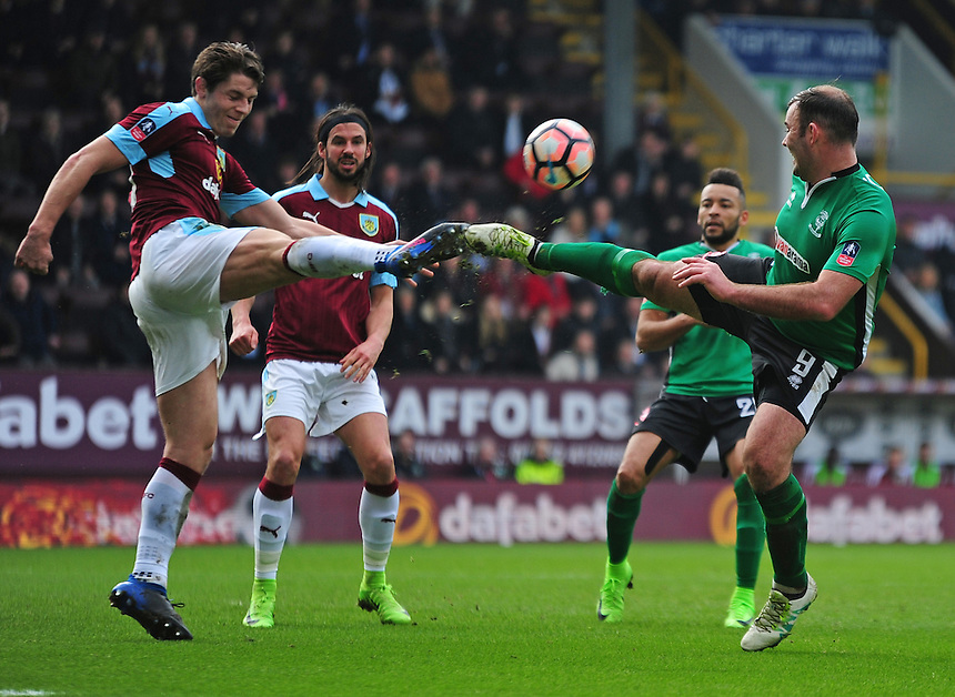 Lincoln City's Matt Rhead vies for possession with Burnley's James Tarkowski<br /> <br /> Photographer Andrew Vaughan/CameraSport<br /> <br /> Emirates FA Cup Fifth Round - Burnley v Lincoln City - Saturday 18th February 2017 - Turf Moor - Burnley <br />  <br /> World Copyright &copy; 2017 CameraSport. All rights reserved. 43 Linden Ave. Countesthorpe. Leicester. England. LE8 5PG - Tel: +44 (0) 116 277 4147 - admin@camerasport.com - www.camerasport.com