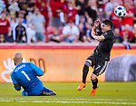 Colorado Rapids goalkeeper Tim Howard (1) slides toward Real Salt Lake forward Jefferson Savarino (7) after blocking the attempt on goal with his arm outside the penalty box in the first half Saturday, April 21, 2018, during the Major League Soccer game at Rio Tiinto Stadium in Sandy, Utah. RSL beat the Colorado Rapids 3-0. (© 2018 Douglas C. Pizac)
