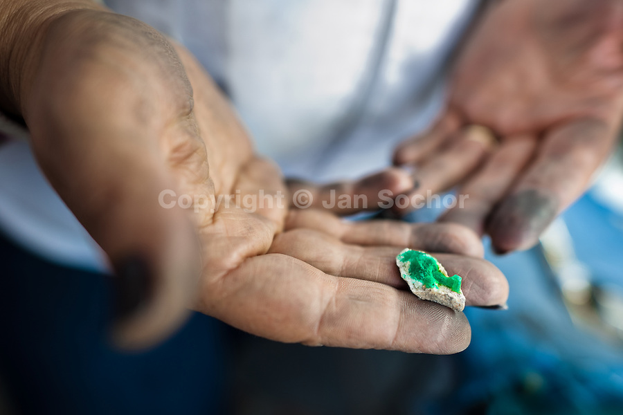 An emerald cutter shows a rough emerald before being processed in a cutting and polishing workshop in Bogota, Colombia, 7 February 2014. Approximately 60 percent of the world's total amount of emeralds come from Colombia. Most of the rough gems are processed in workshops located in the emerald district in downtown Bogota. Due to their special clarity and deep vivid green color, Colombian gemstones are considered the most beautiful emeralds in the world.