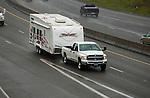 Travel trailer on highway in inclement weather.