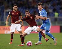 Calcio, Serie A: Roma vs Empoli. Roma, stadio Olimpico, 17 ottobre 2017.<br /> Roma&rsquo;s Miralem Pjanic is challenged by Empoli&rsquo;s Marcel Buchel, right, during the Italian Serie A football match between Roma and Empoli at Rome's Olympic stadium, 17 October 2015.<br /> UPDATE IMAGES PRESS/Isabella Bonotto