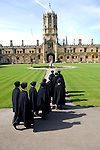 Boys from Christ Church School cross Tom Quad Christ Church during the Sunday Times Oxford Literary Festival, UK, 24 March - 1 April 2012. ..PHOTO COPYRIGHT GRAHAM HARRISON .graham@grahamharrison.com.+44 (0) 7974 357 117.Moral rights asserted.