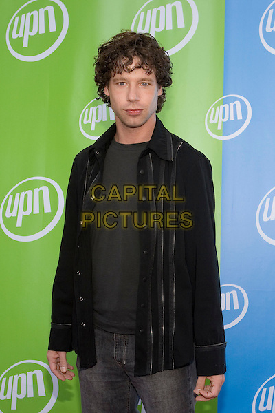 VINCE VIELUF.UPN Summer Press Tour Party .Paramount Studios.Los Angeles, 21st July 2005.half length half-length eye contact black stripe shirt grey t-shirt jeans.www.capitalpictures.com.sales@capitalpictures.com.© Capital Pictures.