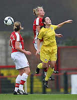 Gilly Flaherty of Arsenal rises above Eva Bartonova - Arsenal Ladies vs Sparta Prague - UEFA Women's Champions League at Boreham Wood FC - 11/11/09 - MANDATORY CREDIT: Gavin Ellis/TGSPHOTO - Self billing applies where appropriate - Tel: 0845 094 6026