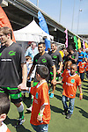 "Kids with The Bachelor's Ian McKee and All My Children's Mark Consuelos as they participate at the ""Kicking It"" at the Annual Tribeca/NYFEST Soccer Day Celebrity Exhibition on April 21, 2012 - NYFEST (which stands for New York Film and Entertainment Soccer Tournament) was designed to mesh the worlds of entertainment, soccer and New York City in conjunction with the Tribeca Film Festival. The day included a film and entertainment industry tournament with 44 teams with one winner the Grassrootsoccer team which Mark Consuelos played on was cofounded by Survivor winner Ethan Zohn. The all-day event took place at Pier 40 in Manhattan, and consisted of an industry tournament, a youth showcase, and a celebrity soccer tournament.  (Photo by Sue Coflin/Max Photos)"