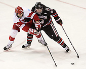 Danny O'Regan (BU - 10), Colton Saucerman (NU - 23) - The Boston University Terriers defeated the visiting Northeastern University Huskies 5-0 on senior night Saturday, March 9, 2013, at Agganis Arena in Boston, Massachusetts.