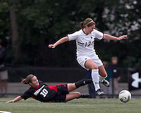 Boston College midfielder/defender Alicia Blose (13) maintains focus to collect pass intended for NC State midfielder Julia Sandridge (10).  Boston College defeated North Carolina State,1-0, on Newton Campus Field, on October 23, 2011.