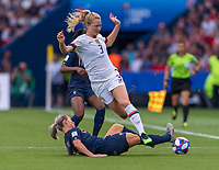 PARIS,  - JUNE 28: Amandine Henry #6 tackles Sam Mewis #3 during a game between France and USWNT at Parc des Princes on June 28, 2019 in Paris, France.
