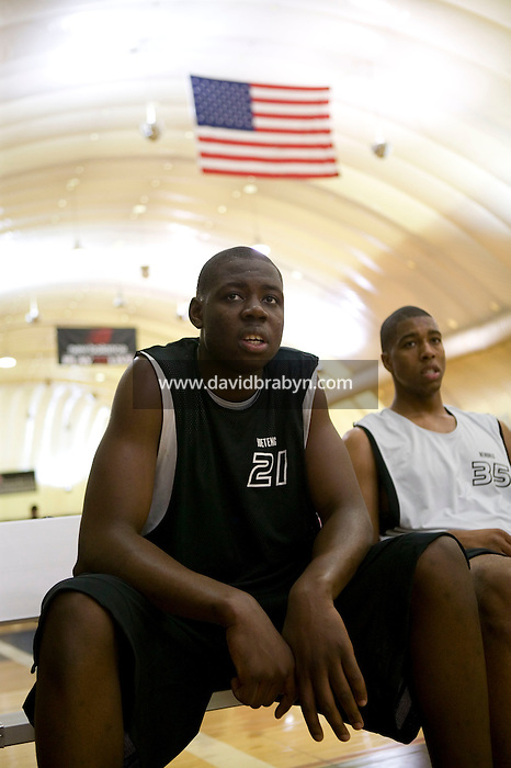 Eric Boateng (L) watches a practice game at the Basketball City complex in New York City, United States, 14 April 2005, preparing for the 2005 Jordan Classic game.
