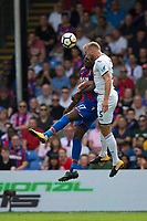 Swansea City's Mike van der Hoorn wins a header from Crystal Palace's Christian Benteke    <br /> <br /> <br /> Photographer Craig Mercer/CameraSport<br /> <br /> The Premier League - Crystal Palace v Swansea City - Saturday 26th August 2017 - Selhurst Park - London<br /> <br /> World Copyright &copy; 2017 CameraSport. All rights reserved. 43 Linden Ave. Countesthorpe. Leicester. England. LE8 5PG - Tel: +44 (0) 116 277 4147 - admin@camerasport.com - www.camerasport.com