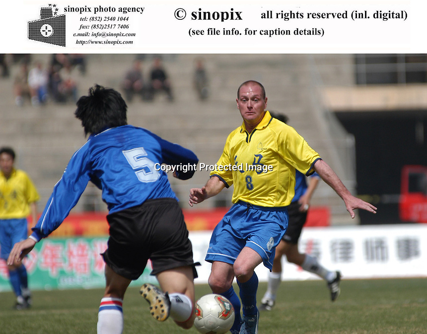 Former England international Paul Gascoigne of Gansu Tianma fights for the ball with defender Qingdao Hailifeng and then have a goal in Lanzhou, the capital of China's north-west Gansu province. Tianma won 2-0 at the match.<br />29-MAR-03