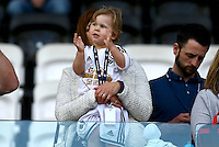 A young Swansea City fan cheers his side on during the Barclays Premier League match between Swansea City and Manchester City played at The Liberty Stadium, Swansea on 15th May 2016