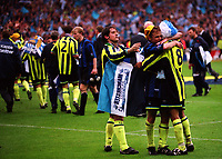 Ian Bishop of Manchester City gets in line to hug No 8, Jeff Whitley as Manchester City celebrate winning the Division Two Play-Off Final during Manchester City vs Gillingham, Nationwide League Division Two Football at Wembley Stadium on 30th May 1999