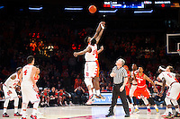 NEW YORK, NY - Sunday December 13, 2015: Syracuse and St. John's tip off.  St. John's defeats Syracuse 84-72 during the NCAA men's basketball regular season at Madison Square Garden in New York City.