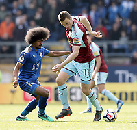 Burnley's Chris Wood under pressure from Leicester City's Hamza Choudhury<br /> <br /> Photographer Rich Linley/CameraSport<br /> <br /> The Premier League - Burnley v Leicester City - Saturday 14th April 2018 - Turf Moor - Burnley<br /> <br /> World Copyright &copy; 2018 CameraSport. All rights reserved. 43 Linden Ave. Countesthorpe. Leicester. England. LE8 5PG - Tel: +44 (0) 116 277 4147 - admin@camerasport.com - www.camerasport.com