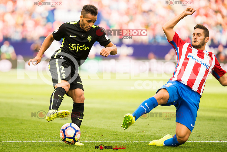 Atletico de Madrid's player Koke Resurrección and Sporting de Gijon's player Douglas during a match of La Liga Santander at Vicente Calderon Stadium in Madrid. September 17, Spain. 2016. (ALTERPHOTOS/BorjaB.Hojas) /NORTEPHOTO