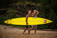 Waimea Bay, North Shore of Oahu, Hawaii.  December 4 2014) Tom Carroll (AUS) with partner Mary. - The Opening Ceremony of the 2014 Quiksilver In Memory of Eddie Aikau contest was held this afternoon in the park at Waimea Bay. This winter, the big wave riding event celebrates a special milestone of 30 years. <br /> The Quiksilver In Memory of Eddie Aikau is a one-day big wave riding event that only takes place if and when waves meet a 20-foot minimum height, during the holding period of December 1 through February 28, each Hawaiian winter. The official Opening Ceremony with the Aikau Family will be held on Thursday, December 4th, 3pm, at Waimea Bay.<br />  <br /> &quot;The Eddie&quot; is the original big wave riding event and stands as the measure for every big wave event that exists in the world today. It has become an icon of surfing through its honor, integrity and rarity.<br />  <br /> The event honors Hawaiian hero Eddie Aikau, whose legacy is the respect he held for the ocean; his concern for the safety of all who entered it on his watch; and the way with which he rode Waimea Bay on its most giant and memorable days. <br />  <br /> Adherence to strict wave height standards has ensured its integrity; it is only held on days when waves meet or exceed the Hawaiian 20-foot minimum (wave face heights of approximately 40 feet). This was the threshold at which Eddie enjoyed to ride the Bay. It has been said that what makes The Eddie special is the times it doesn't run, because that is precisely its guarantee of integrity and quality days of giant surf.<br />  <br /> The competition has only been held a total of 8 times: it's inaugural year at Sunset Beach, and then seven more times at its permanent home of Waimea Bay. The Eddie was last held on December 9, 2009, won by California's Greg Long.   Photo: joliphotos.com