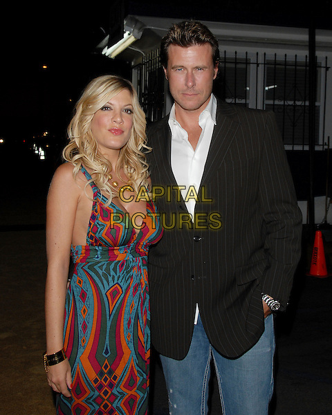 "TORI SPELLING & DEAN McDERMOTT.Mark Burnett & AOL's Launch of ""Gold Rush"" interactive reality competition held at Les Deux in Hollywood, California, USA..September 12th, 2006.Ref: DVS.half length fuschia blue turquoise mulitcoloured pattern dress purple orange blue married couple husband wife black pinstripe suit jacket .www.capitalpictures.com.sales@capitalpictures.com.©Debbie VanStory/Capital Pictures"