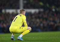 26th December 2019; Goodison Park, Liverpool, Merseyside, England; English Premier League Football, Everton versus Burnley; Everton goalkeeper Jordan Pickford sits on his haunches as he follows the action - Strictly Editorial Use Only. No use with unauthorized audio, video, data, fixture lists, club/league logos or 'live' services. Online in-match use limited to 120 images, no video emulation. No use in betting, games or single club/league/player publications
