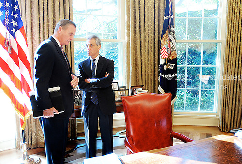 Washington, DC - November 3, 2009 -- National security adviser James Jones (left) and White House Chief Of Staff Rahm Emanuel , stand behind the desk in the Oval Office during a meeting between United States President Barack Obama (not pictured) and Chancellor Angela Merkel of Germany (not pictured) in the Oval Office of the White House, Tuesday, November 3, 2009 in Washington, DC..Credit: Olivier Douliery / Pool via CNP