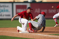 Palm Beach Cardinals third baseman Nolan Gorman (18) attempts to tag Matt Vierling (28) sliding into the base during a Florida State League game against the Clearwater Threshers on August 9, 2019 at Roger Dean Chevrolet Stadium in Jupiter, Florida.  Clearwater defeated Palm Beach 5-3 in the first game of a doubleheader.  (Mike Janes/Four Seam Images)