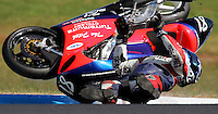 The Australian Motorcycle Grand Prix at Phillip island. Wildcard rider Mark Rowling tumbles after crashing and breaking his right leg.