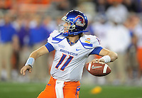 Jan. 4, 2010; Glendale, AZ, USA; Boise State Broncos quarterback (11) Kellen Moore throws a pass in the first quarter against the TCU Horned Frogs in the 2010 Fiesta Bowl at University of Phoenix Stadium. Boise State defeated TCU 17-10. Mandatory Credit: Mark J. Rebilas-