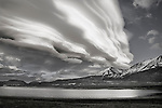 A black and white photo of a lenticular cloud above Crowley Lake in the eastern Sierra , Ca.