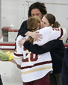 Courtney Kennedy (BC - Associate Head Coach), Kate Leary (BC - 28), Katie King Crowley (BC - Head Coach) -  The Boston College Eagles defeated the visiting Boston University Terriers 5-0 on BC's senior night on Thursday, February 19, 2015, at Kelley Rink in Conte Forum in Chestnut Hill, Massachusetts.