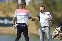 Maverick Antcliff (AUS) and Jordan Smith (ENG) on the 18th green during the 3rd round of  the Saudi International powered by Softbank Investment Advisers, Royal Greens G&CC, King Abdullah Economic City,  Saudi Arabia. 01/02/2020<br /> Picture: Golffile | Fran Caffrey<br /> <br /> <br /> All photo usage must carry mandatory copyright credit (© Golffile | Fran Caffrey)