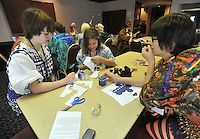 NWA Media/Michael Woods --12/14/2014-- w @NWAMICHAELW...(left to right) Marie Whelan from Peculiar, Missouri, Caitlyn Rowland from Bella Vista and Lexie Phillips from Peculiar, Missouri, work on a paper craft TARDIS (Time And Relative Dimension In Space) project from Dr. Who, during the NWA Anime Festival at the Holiday Inn in Springdale.