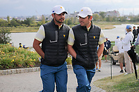 Anirban Lahiri (IND) and Louis Oosthuizen (RSA) make their way to 15 during round 3 Four-Ball of the 2017 President's Cup, Liberty National Golf Club, Jersey City, New Jersey, USA. 9/30/2017.<br /> Picture: Golffile | Ken Murray<br /> <br /> All photo usage must carry mandatory copyright credit (&copy; Golffile | Ken Murray)