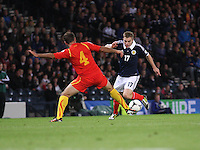 James Forrest being tackled by Nikolche Noveski in the Scotland v Macedonia FIFA World Cup Qualifying match at Hampden Park, Glasgow on 11.9.12.